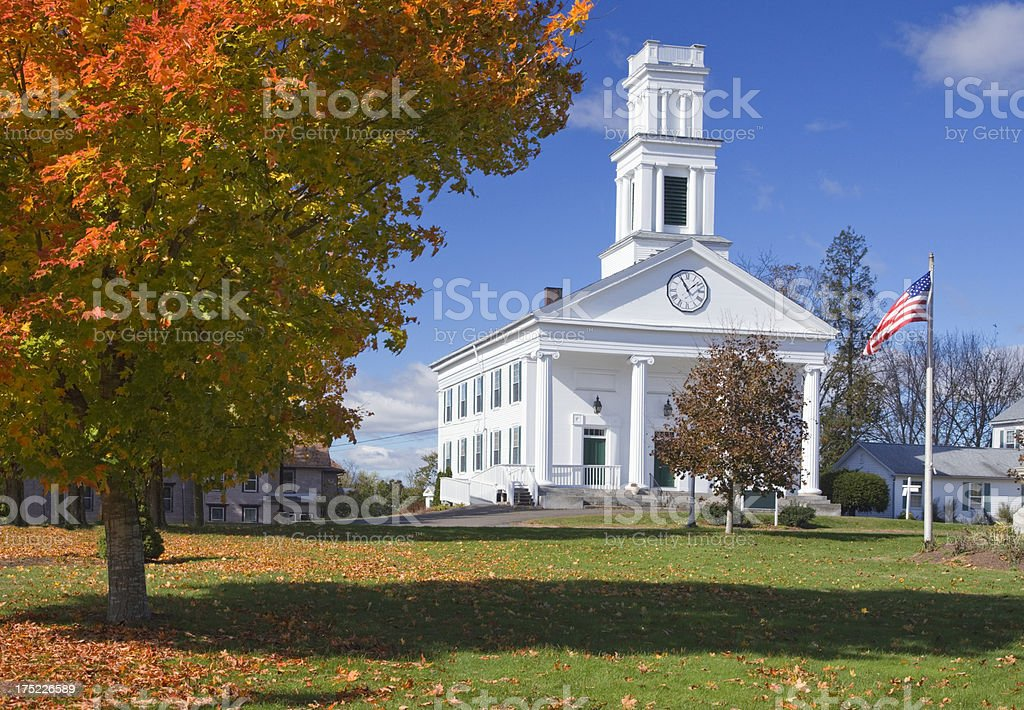 Beautiful White church, Plymouth, Connecticut, with autumn colored trees stock photo