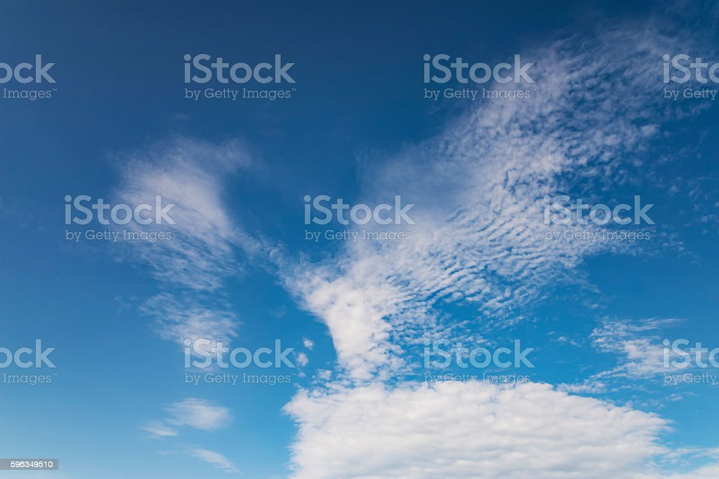 beautiful white clouds against the background of the clear blue sky royalty-free stock photo