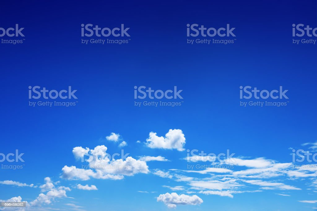 beautiful white clouds on blue sky for background and design stock photo