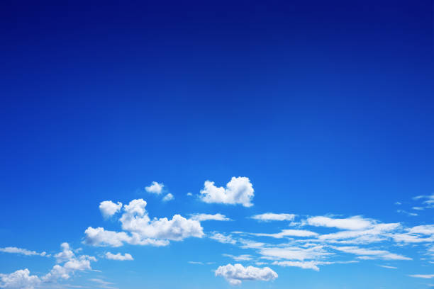 beautiful white clouds on blue sky for background and design - dark blue stock pictures, royalty-free photos & images