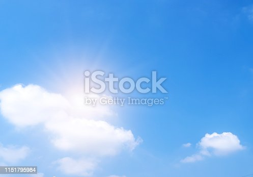 istock Beautiful white clouds with sun on blue sky.Color shade gradient from white to blue for background wallpaper. 1151795984