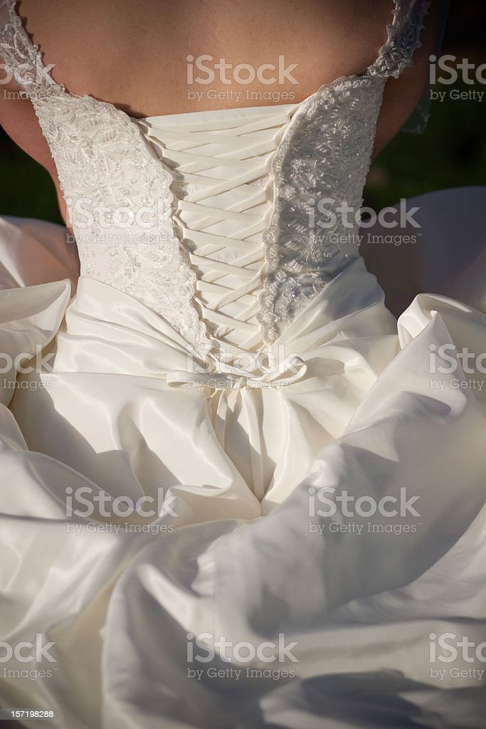 Beautiful White Couture Wedding Gown with Lace Back royalty-free stock photo