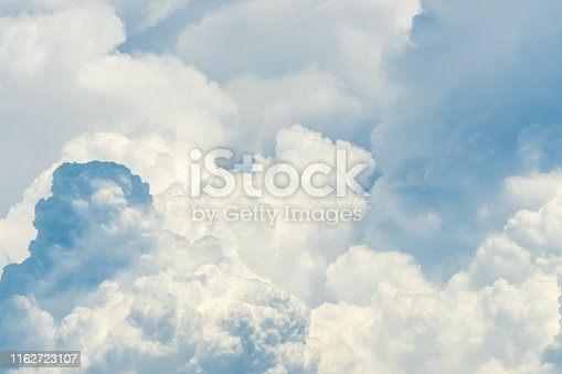 Beautiful white fluffy cloud abstract background. Cloudscape.  Fluffy white clouds on sunny day. Nature weather. Soft like cotton texture of cloud. Puffy clouds. Wish and peaceful concept. Sunshine.