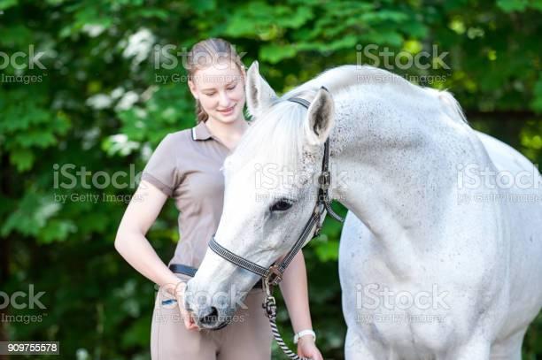Beautiful white horse treats from young teenage girls hand picture id909755578?b=1&k=6&m=909755578&s=612x612&h= wd1nut22cvn yo5qasc0kygai9z2vjeo8vnbn6agec=