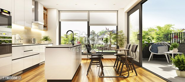 Beautiful white kitchen with large windows and a terrace in the modern home