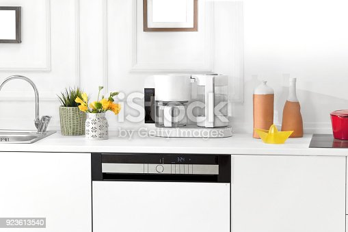 923629650istockphoto Beautiful white kitchen in new luxury home 923613540