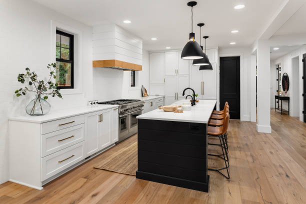 Beautiful white kitchen with dark accents in new farmhouse style luxury home stock photo