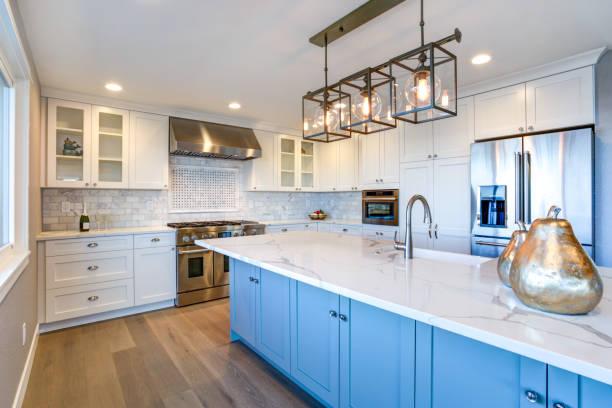 Beautiful white kitchen with large island. stock photo