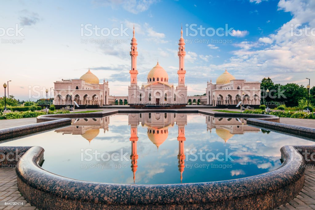 Beautiful White Mosque with Reflection  on Water at Sunset Light stock photo