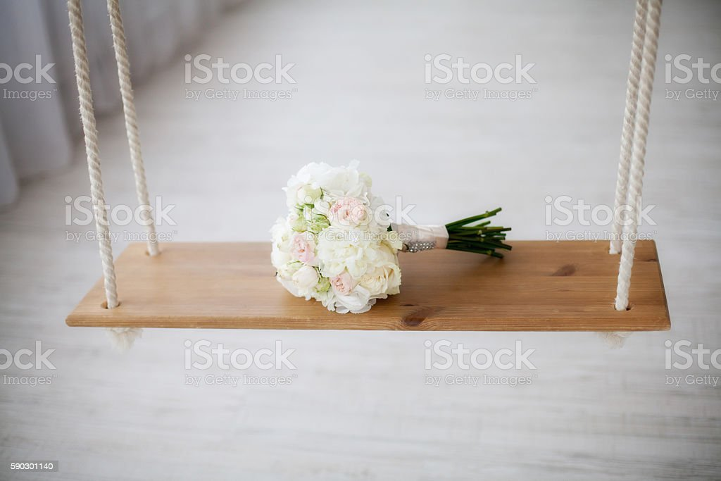 Beautiful white peony wedding bouquet on swing. Marriage concept Стоковые фото Стоковая фотография