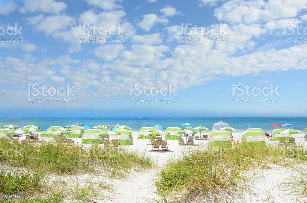 Beautiful white sand beach with cloudy sky. stock photo