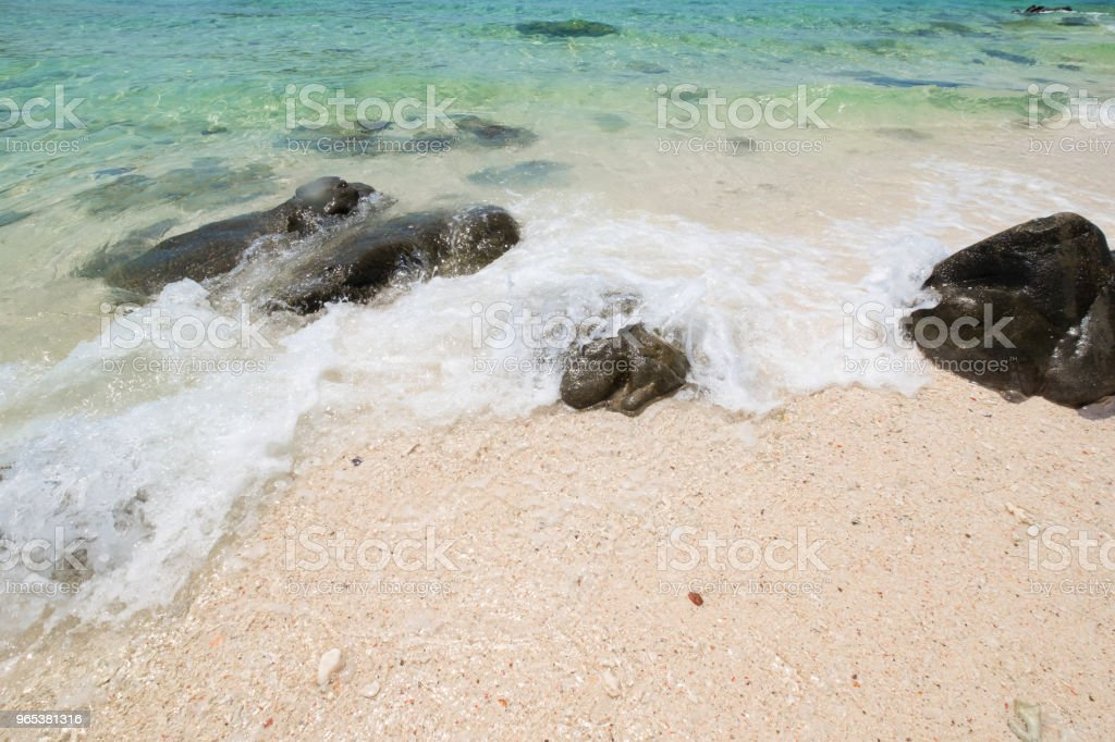 beautiful white sand beach with soft ocean wave and rocks in summer time, wave of the blue sea on the sand bech. concept travel. royalty-free stock photo