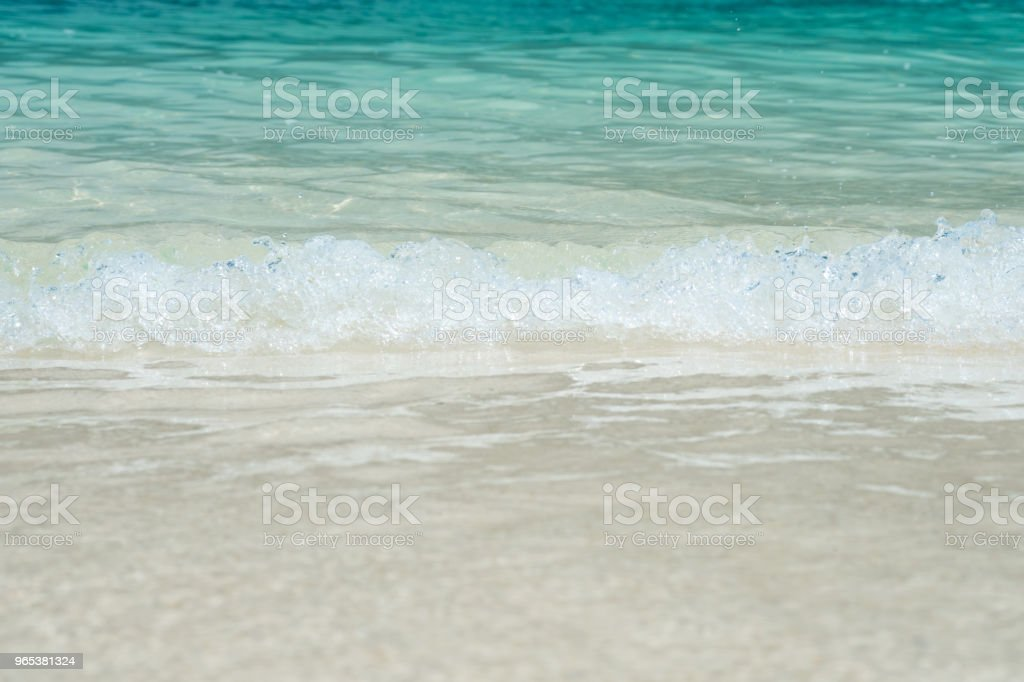 beautiful white sand beach with soft ocean wave in summer time, wave of the blue sea on the sand bech. concept travel. royalty-free stock photo