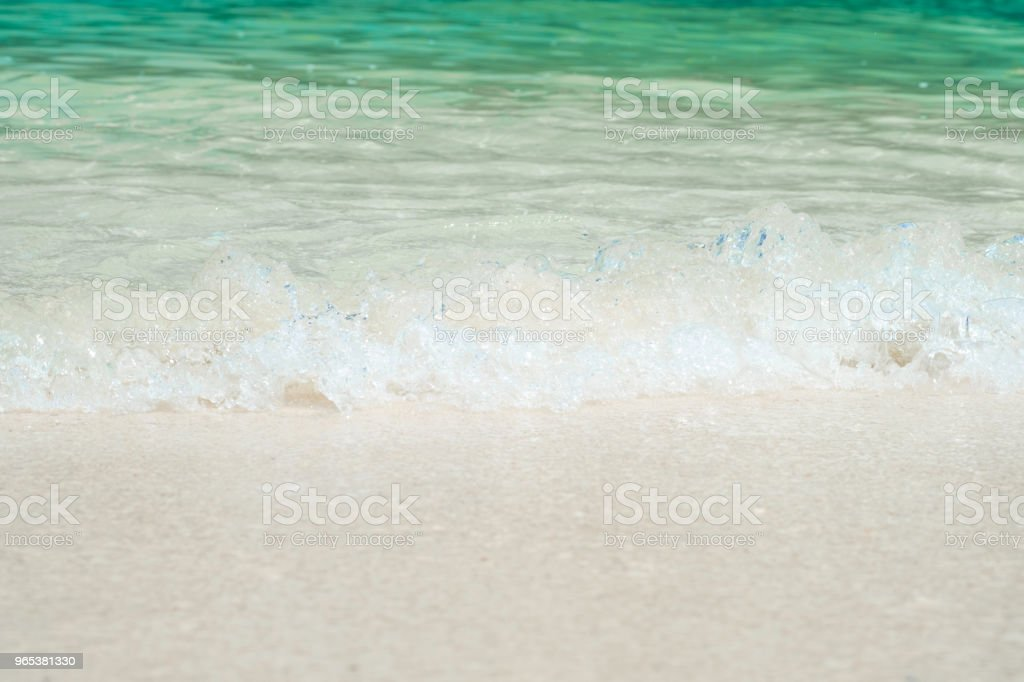 beautiful white sand beach with soft ocean wave in summer time, wave of the blue sea on the sand bech. concept travel. stock photo