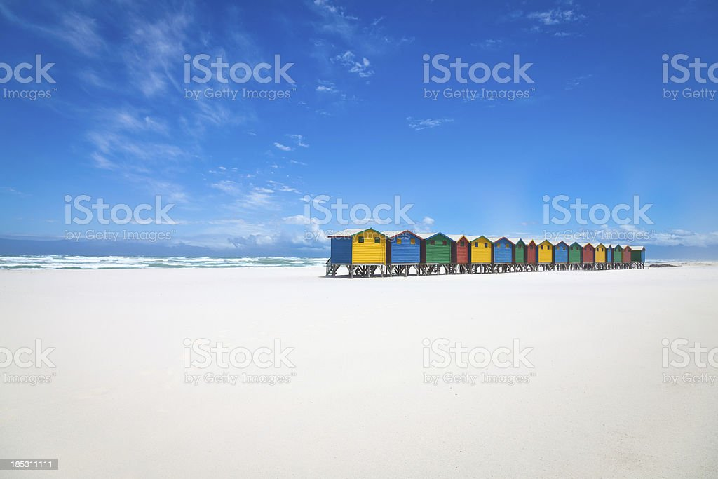 Beautiful white sandy beach with colorful huts royalty-free stock photo