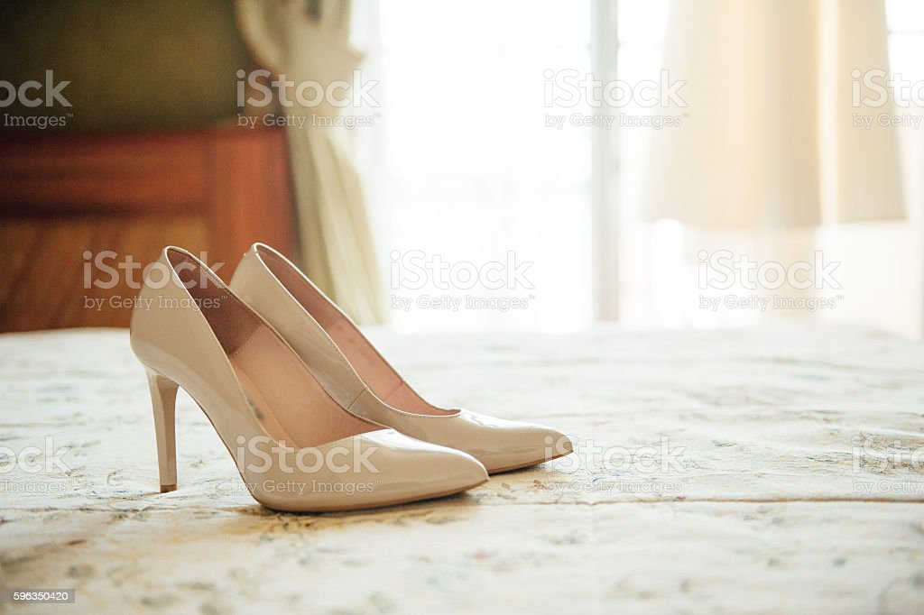 beautiful white shoes from bride with other props royalty-free stock photo