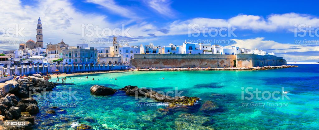 Beautiful white town Monopoli in Puglia with turquoise sea. Italy stock photo