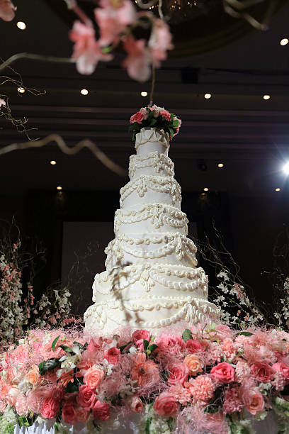 beautiful white wedding cake luxury in marriage ceremony - big cake stock photos and pictures