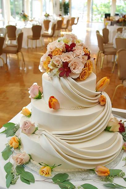 Beautiful white wedding cake with roses. stock photo