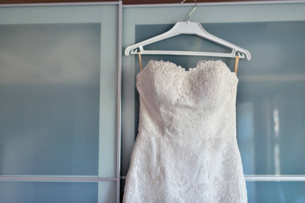 Beautiful white wedding dress for bride indoors stock photo