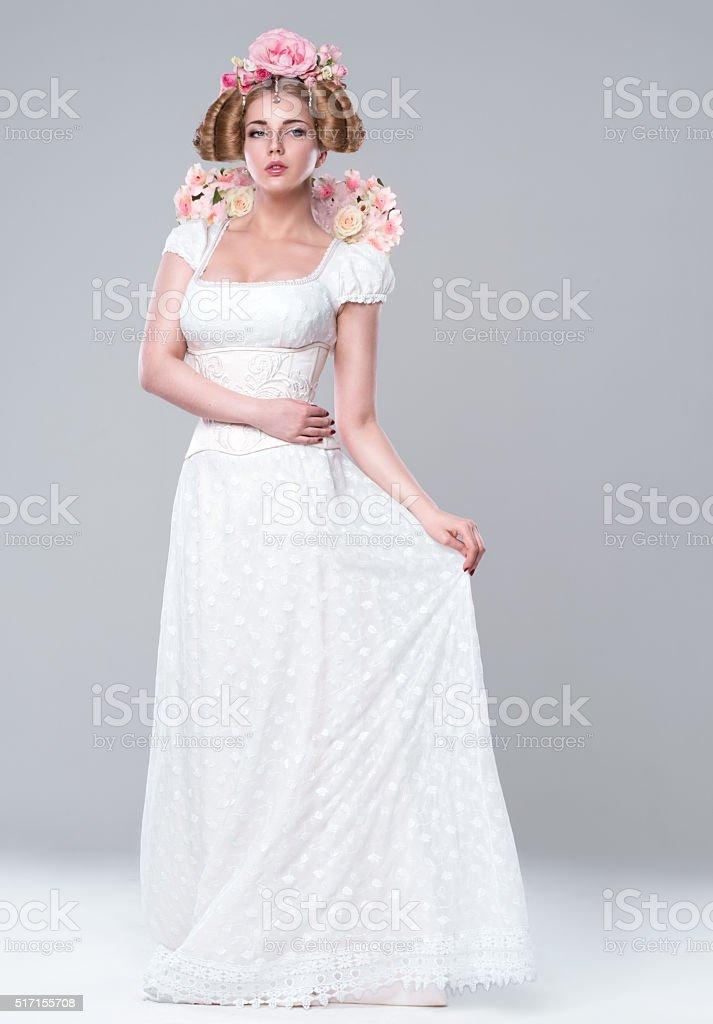 Beautiful white woman in a wedding white dress stock photo