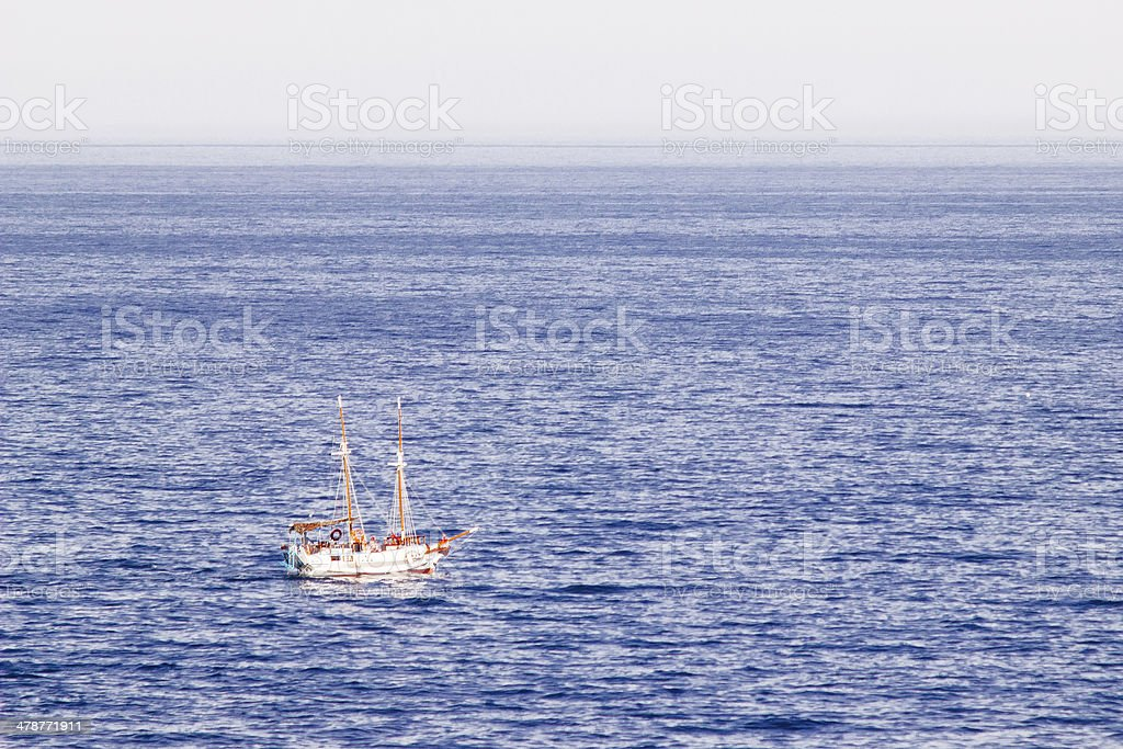 Beautiful white yacht in the blue sea stock photo