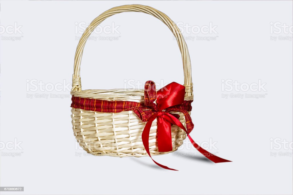 Beautiful wicker basket with red bow isolated on white background royalty-free stock photo