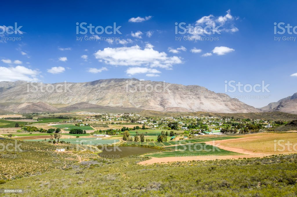 Beautiful wide angle view of Barrydale,  located on the border of the Overberg and Klein Karoo regions, Western Cape Province in South Africa. Barrydale is a famous town along Route 62. stock photo