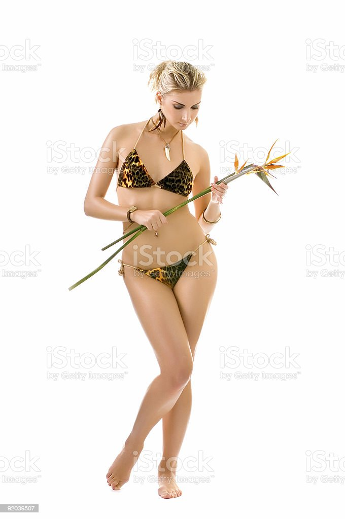 Beautiful wild woman with bird of paradise flower royalty-free stock photo