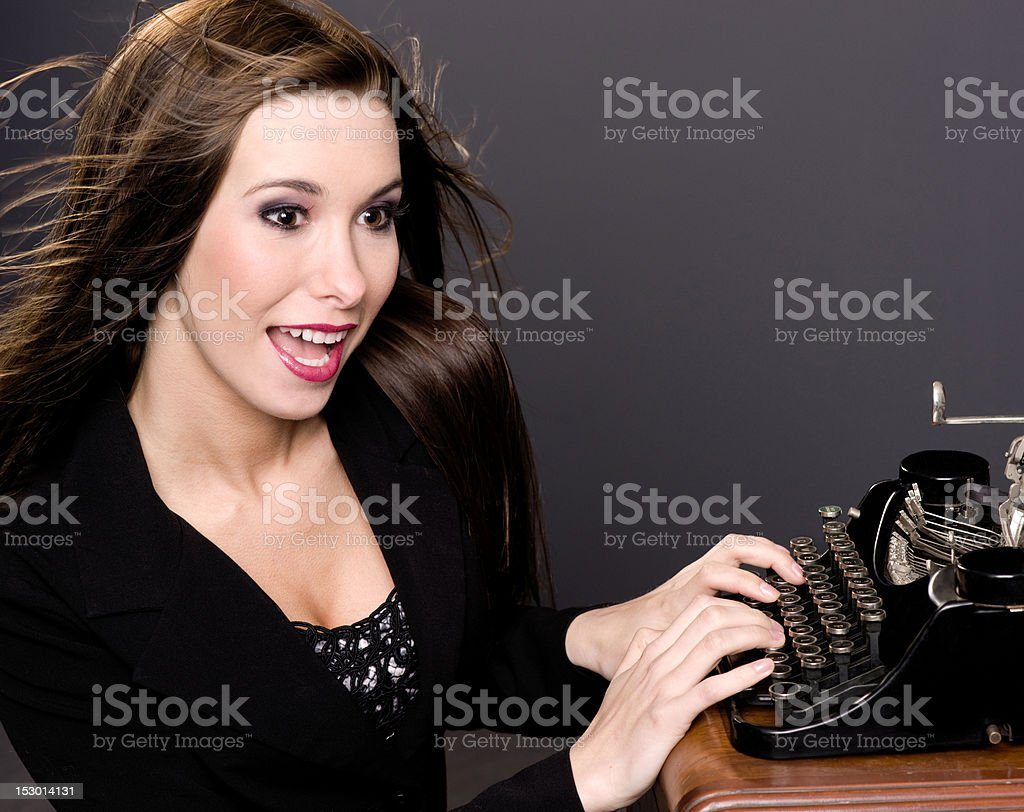 Beautiful Windblown Female Author Pecks Creating With Vintage Typewriter royalty-free stock photo