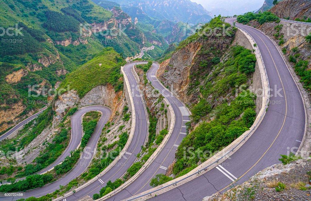 beautiful winding mountain road stock photo