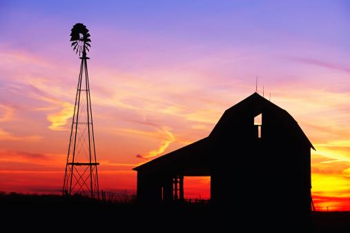 istock Beautiful windmill and barn at sunset 511473329