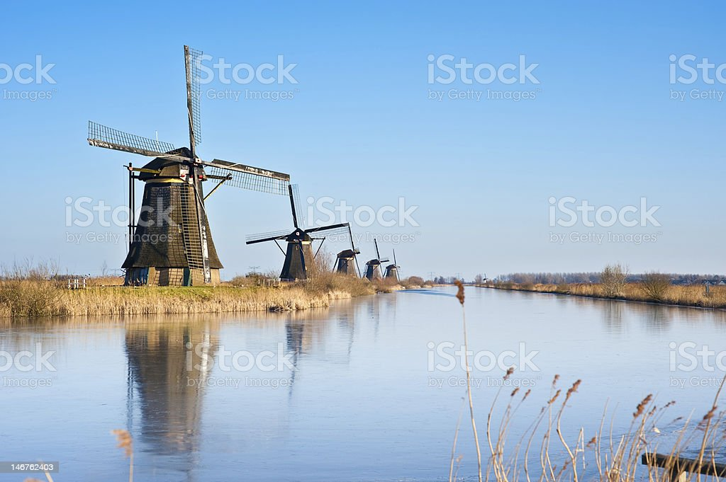 beautiful windmill landscape at kinderdijk royalty-free stock photo