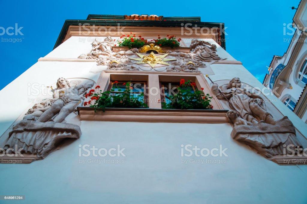 beautiful window in Prague tameing old stucco stock photo
