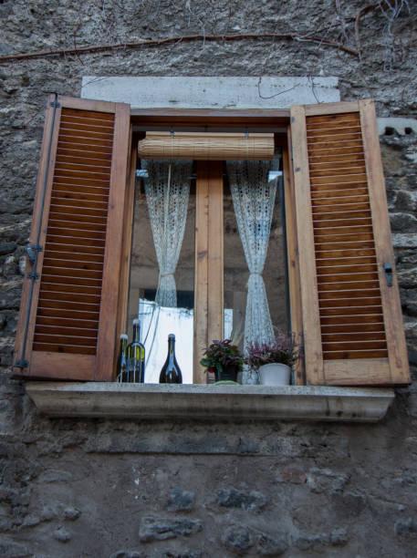 beautiful windows in old town in tivoli - batalina italy стоковые фото и изображения
