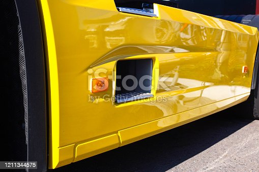 A beautiful wing made of plastic on a truck for the best aerodynamics of the car. Step for the cabin entrance, background