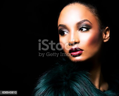 istock beautiful winter glamour woman 636945610