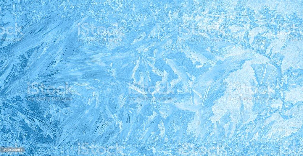 beautiful winter ice, blue texture on window, festive background stock photo