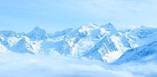 beautiful winter landscape of caucasus mountains with clouds - snowy mountains stock photos and pictures