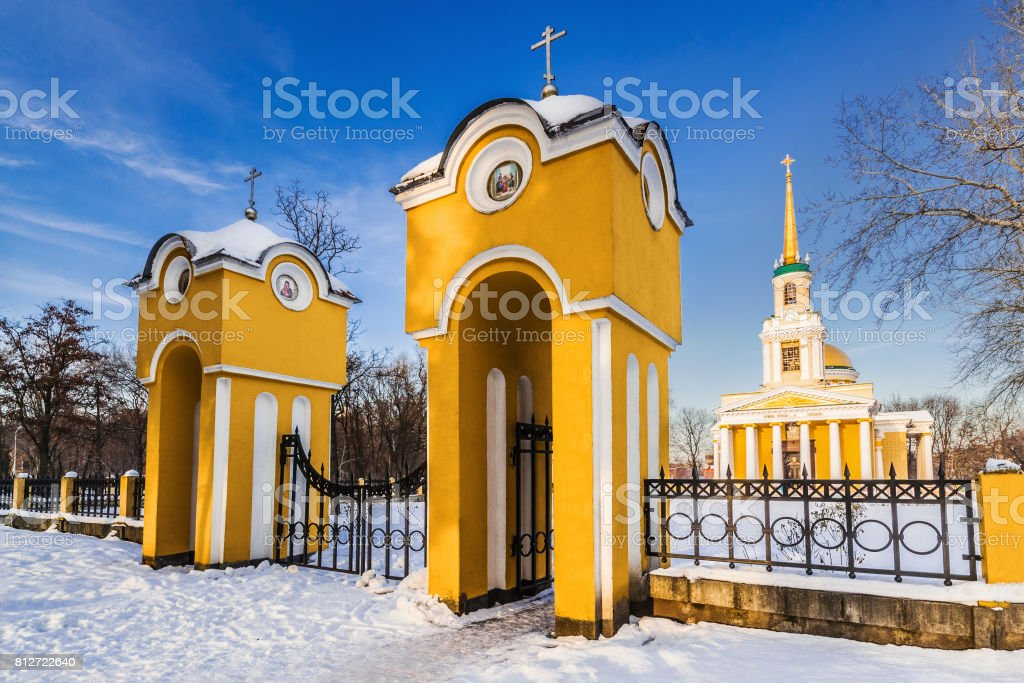 Beautiful Winter landscape of Peter and Paul Cathedral in the golden rays of the rising sun II stock photo