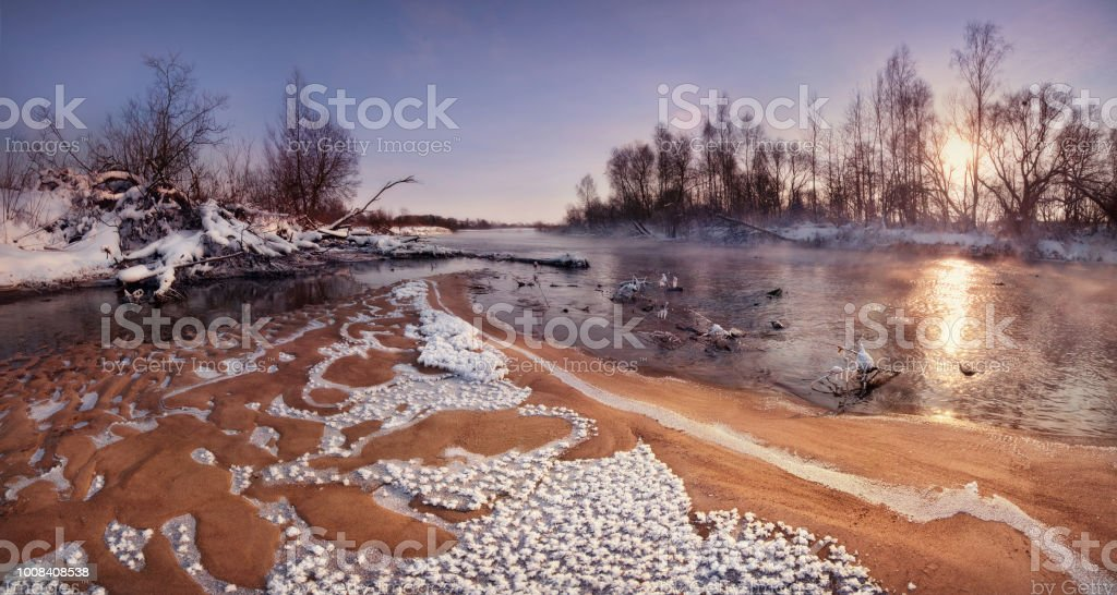 The Sun Rising Over The Forest And The Sandy Shallows Of The River,...
