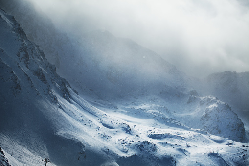 istock Beautiful winter mountains on stormy weather 642321600