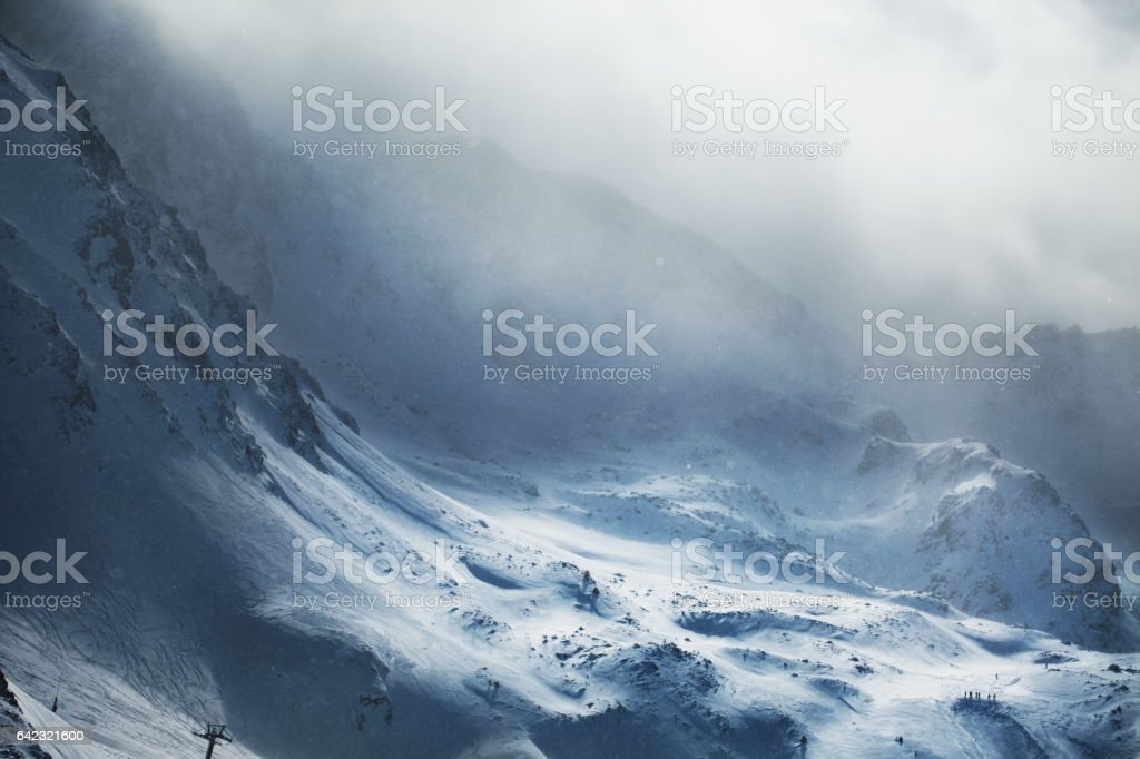 Beautiful winter mountains on stormy weather stock photo
