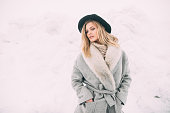 istock Beautiful winter portrait of young woman in the winter snowy scenery. 891965768