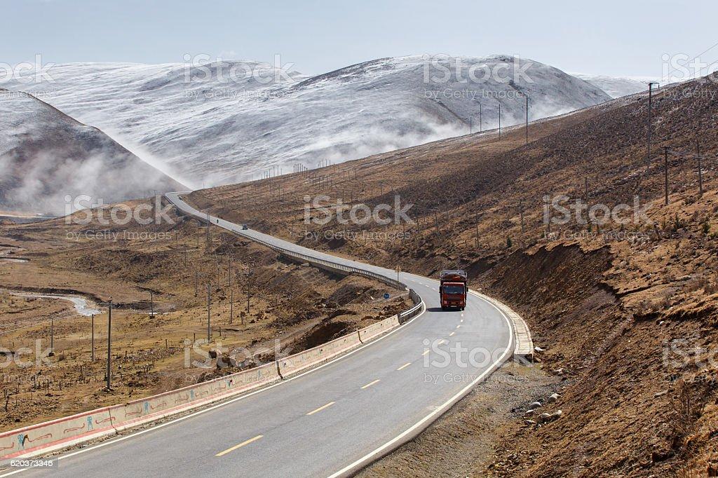 Beautiful winter road in Tibet under snow mountain, Sichuan zbiór zdjęć royalty-free