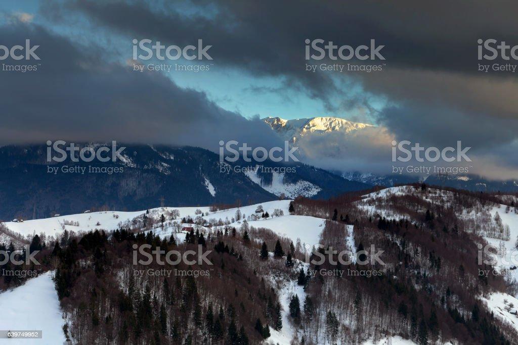 Beautiful winter sunset, in Bucegi mountains stock photo