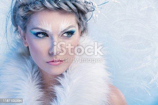 istock beautiful winter woman 1187100394