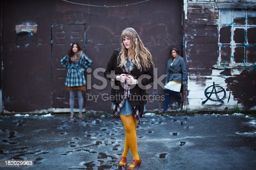 Beautiful hipster fashion models at a grunge location. Shot January 2012