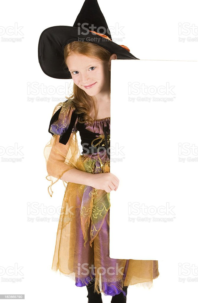 Beautiful witch holding blank, white sign royalty-free stock photo