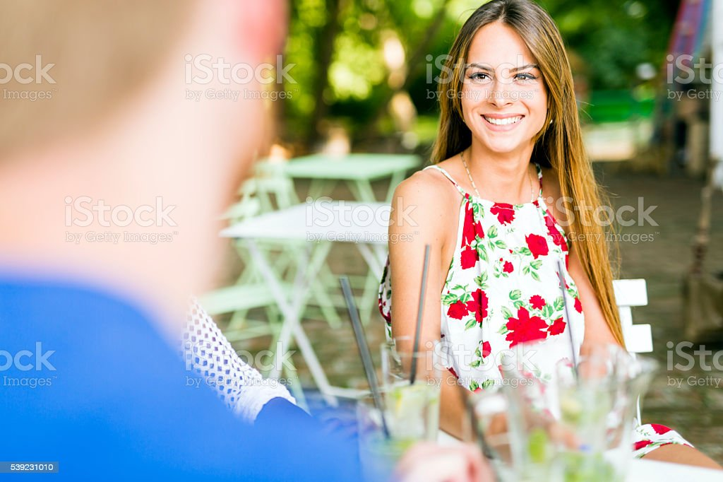 Beautiful woman and a handsome man flirting dating royalty-free stock photo